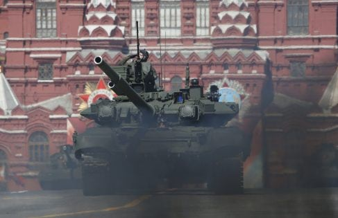Russian servicemen drive a T-90A main battle tank during the Victory Day parade, marking the 71st anniversary of the victory over Nazi Germany in World War Two, at Red Square in Moscow, Russia, May 9, 2016. REUTERS/Sergei Karpukhin