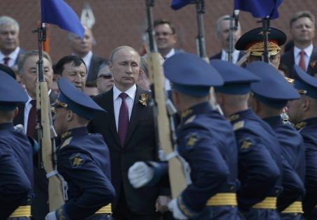 Russian President Vladimir Putin watches honor guards passing by during a wreath-laying ceremony to mark the 71st anniversary of the victory over Nazi Germany in World War Two, at the Tomb of the Unknown Soldier by the Kremlin walls in Moscow, Russia, May 9, 2016. REUTERS/Maxim Shemetov