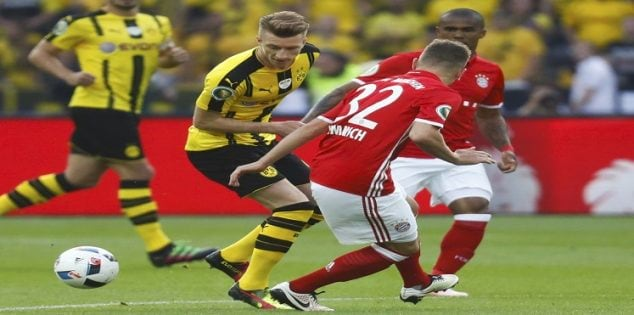 Football Soccer - Bayern Munich v Borussia Dortmund - German Cup (DFB Pokal) Final - Olympiastadion, Berlin, Germany - 21/05/16. Borussia Dortmund's Marco Reus and Bayern Munich's Joshua Kimmich in action. REUTERS/Kai Pfaffenbach DFB RULES PROHIBIT USE IN MMS SERVICES VIA HANDHELD DEVICES UNTIL TWO HOURS AFTER A MATCH AND ANY USAGE ON INTERNET OR ONLINE MEDIA SIMULATING VIDEO FOOTAGE DURING THE MATCH.