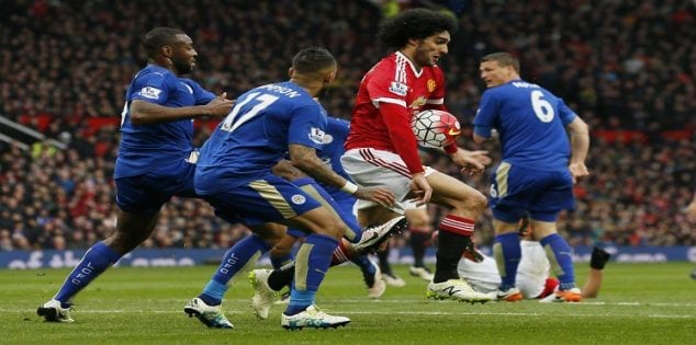 "Britain Football Soccer - Manchester United v Leicester City - Barclays Premier League - Old Trafford - 1/5/16 Leicester City's Danny Simpson and Wes Morgan in action with Manchester United's Marouane Fellaini Action Images via Reuters / Jason Cairnduff Livepic EDITORIAL USE ONLY. No use with unauthorized audio, video, data, fixture lists, club/league logos or ""live"" services. Online in-match use limited to 45 images, no video emulation. No use in betting, games or single club/league/player publications. Please contact your account representative for further details."