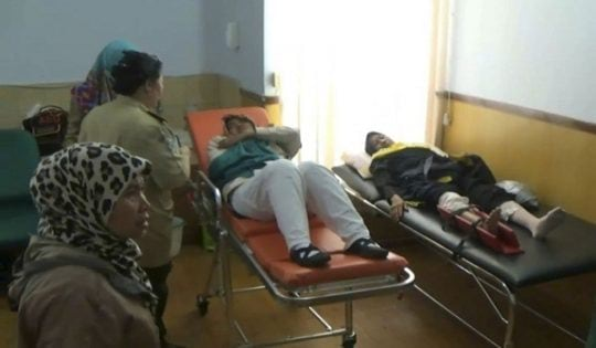In this image made from video, injured passengers of Etihad Flight EY474 receive medical treatment at the health facility at Soekarno-Hatta International Airport in Cengkareng, in the outskirt of Jakarta, Indonesia, Wednesday, May 4, 2016. Dozens of passengers and a crew member aboard the flight were injured Wednesday when their plane ran into sudden turbulence as it prepared to land in the Indonesian capital, Jakarta. (AP Photo/APTN)
