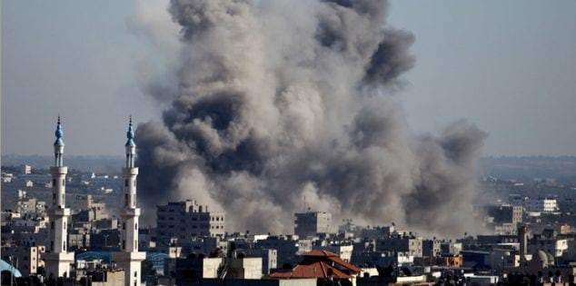 Smoke billows from buildings following an Israeli air strike in Gaza City on July 11, 2014. Israel's aerial bombardment of Gaza claimed its 105th Palestinian life as Hamas pounded central Israel with rockets and Washington offered to help broker a truce. AFP PHOTO/MOHAMMED OTHMAN