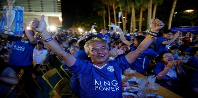 Leicester City fans celebrate after their team scores against Manchester United while watching the game on a big screen, in Bangkok, Thailand, May 1, 2016. REUTERS/Jorge Silva TPX IMAGES OF THE DAY