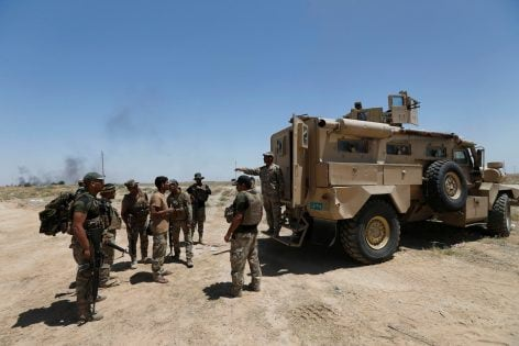 Iraqi soldiers prepare to go to battle against Islamic State militants at the frontline in Falluja