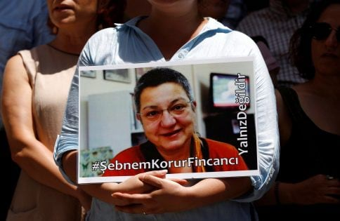 A demonstrator holds picture of Fincanci during a protest against the arrest of three prominent campaigners for press freedom, in front of the pro-Kurdish Ozgur Gundem newspaper in central Istanbul