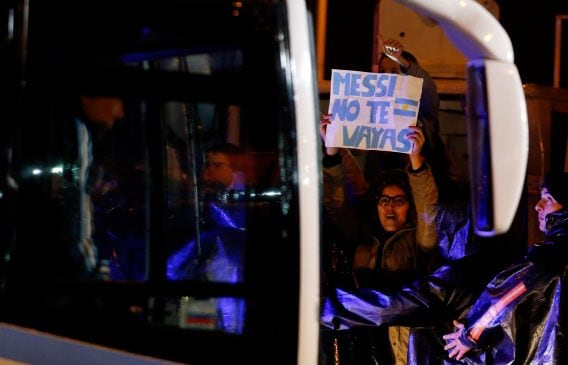 """A fan of Argentina's soccer team holds a sign that reads """"Messi, don't go"""" as the team arrives to their training camp after their participation in the 2016 Copa America Centenario, in Buenos Aires, Argentina, June 27, 2016. REUTERS/Marcos Brindicci"""