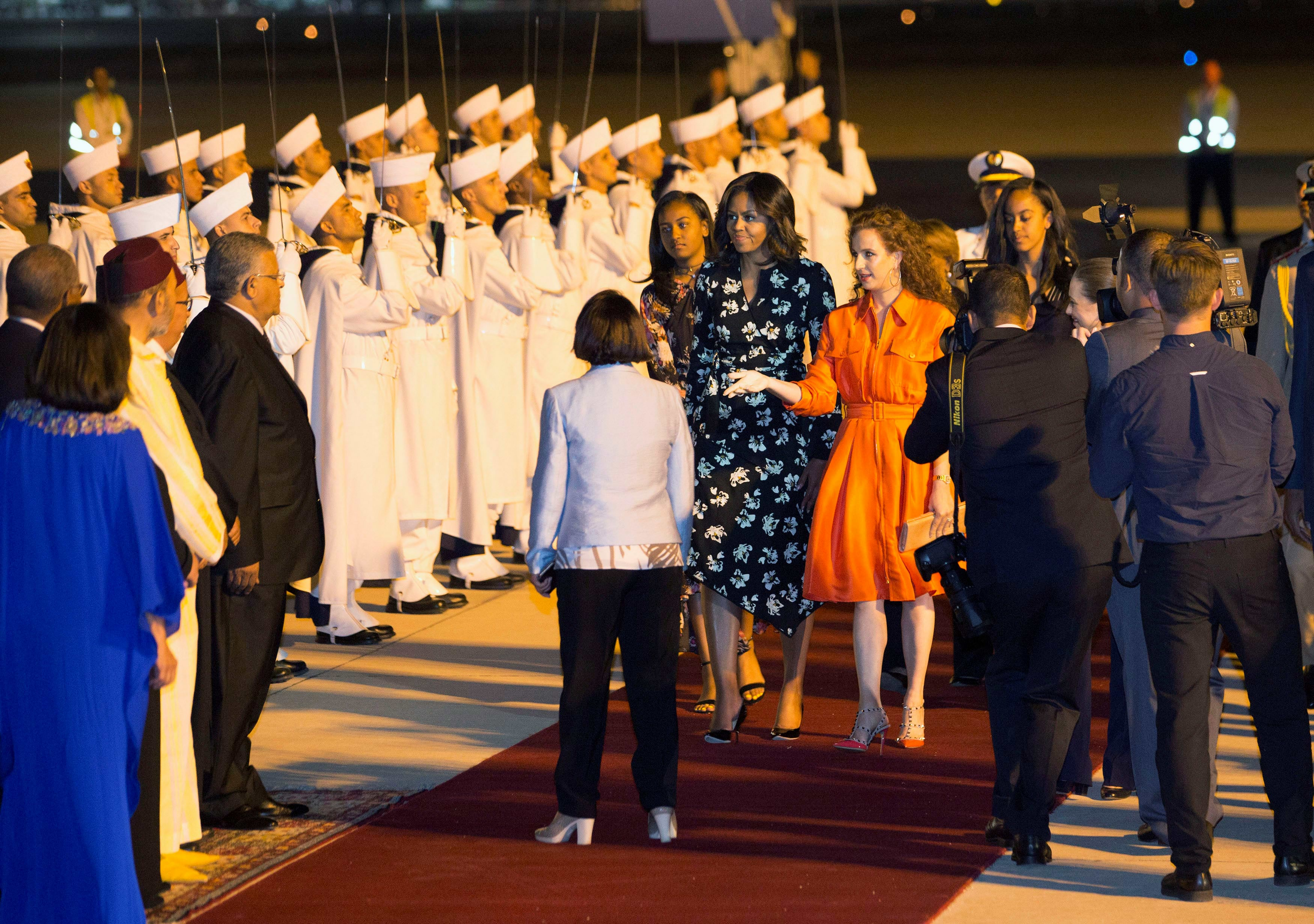 U.S. first lady Michelle Obama with her daughters Sasha and Malia, is welcomed by Princess Lalla Salma (centre, R) of Morocco as she arrives at the Marrakech International Airport, early June 28, 2016. REUTERS/Youssef Boudlal
