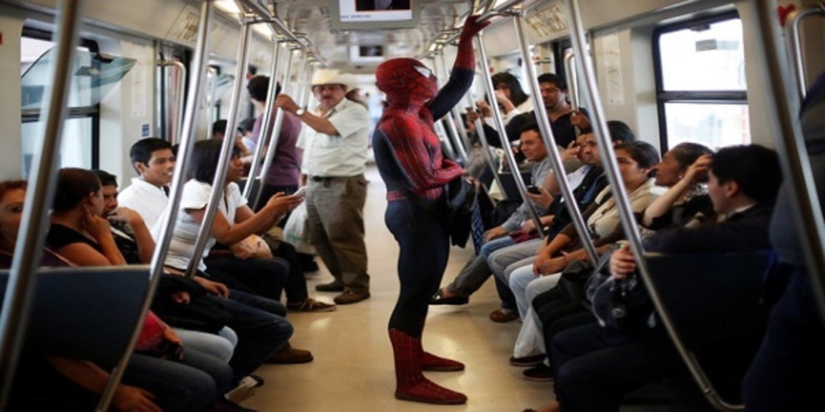 """Moises Vazquez, 26, known as Spider-Moy, a computer science teaching assistant at the Faculty of Science of the National Autonomous University of Mexico (UNAM), who teaches dressed as a comic superhero Spider-Man, travels on a subway on his way to work in Mexico City, Mexico, May 27, 2016. REUTERS/Edgard Garrido SEARCH """"SPIDERMAN TEACHER"""" FOR THIS STORY. SEARCH """"THE WIDER IMAGE"""" FOR ALL STORIES TPX IMAGES OF THE DAY"""