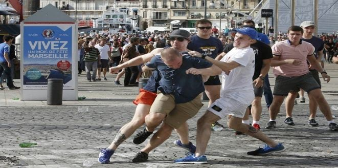 Football Soccer - Euro 2016 - England v Russia - Group B - Marseille, France - 11/6/16 Rival supporters clash at the old port of Marseille before the game. REUTERS/Jean-Paul Pelissier
