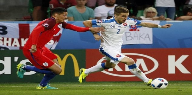 Football Soccer - Slovakia v England - EURO 2016 - Group B - Stade Geoffroy-Guichard, Saint-Étienne, France - 20/6/16 Slovakia's Peter Pekarik in action with England's Chris Smalling REUTERS/Robert Pratta Livepic