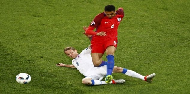 Football Soccer - Slovakia v England - EURO 2016 - Group B - Stade Geoffroy-Guichard, Saint-Etienne, France - 20/6/16 England's Chris Smalling and Slovakia's Ondrej Duda in action REUTERS/Max Rossi
