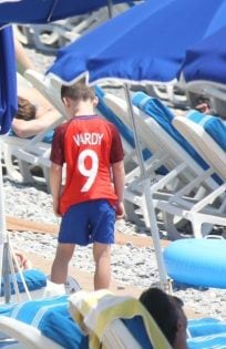 Euro 2016 Nice , France Colleen Rooney on the beach with eldest son Kai wearing a Vardy 9 shirt