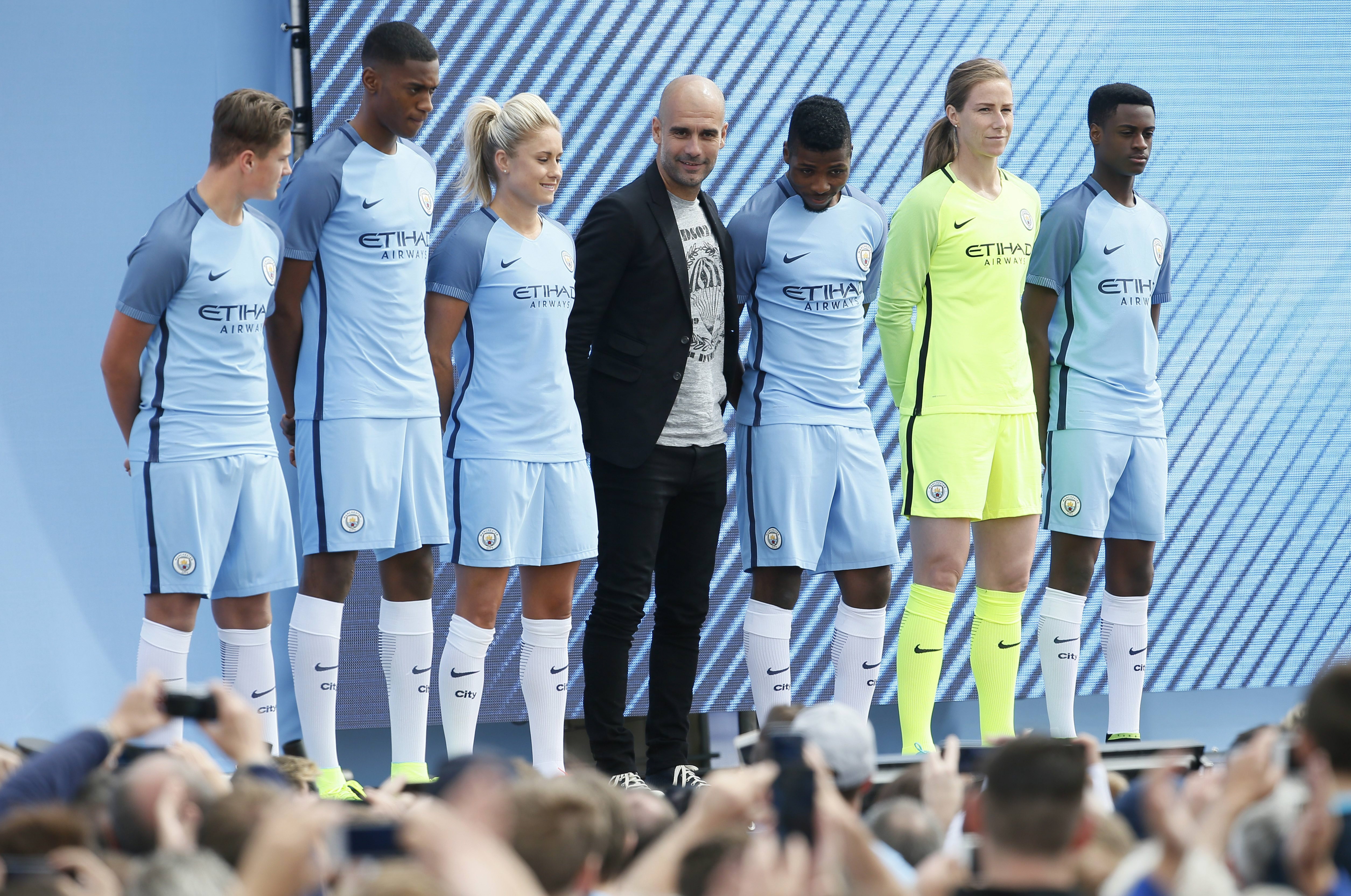 Britain Football Soccer - Pep Guardiola presented to Manchester City fans - City Academy Stadium - 3/7/16 Manchester City manager Pep Guardiola is presented to the fans with Kelechi Iheanacho and Steph Houghton Action Images via Reuters / Craig Brough Livepic EDITORIAL USE ONLY.