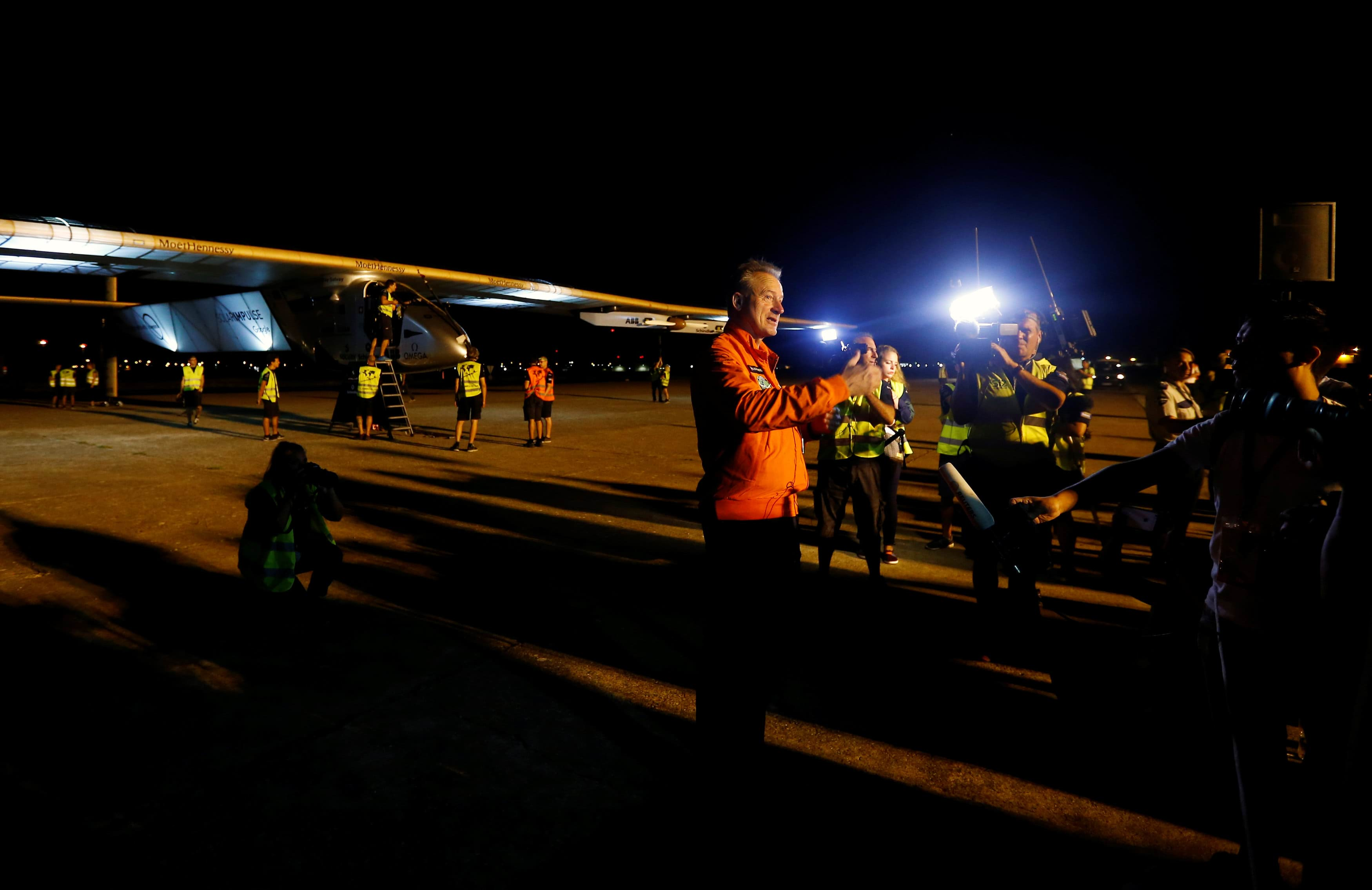 Swiss aviator of the solar-powered plane Solar Impulse 2 Borschberg speaks with journalists before taking off at San Pablo airport in Seville