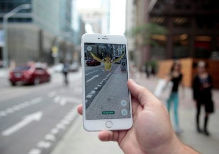 "A ""Pidgey"" Pokemon is seen on the screen of the Pokemon Go mobile app, Nintendo's new scavenger hunt game which utilizes geo-positioning, in a photo illustration taken in downtown Toronto, Ontario, Canada July 11, 2016. REUTERS/Chris Helgren"