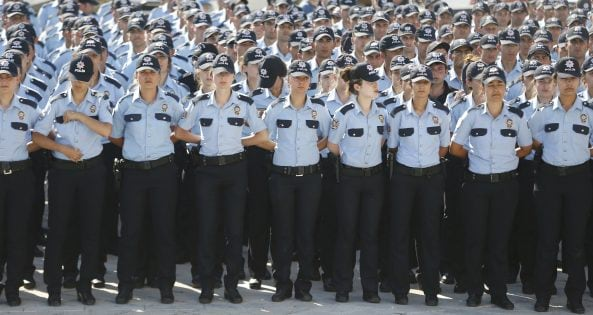 Police officers stand guard for victims of the thwarted coup during a funeral service in Ankara, Turkey, July 17, 2016. REUTERS/Baz Ratner
