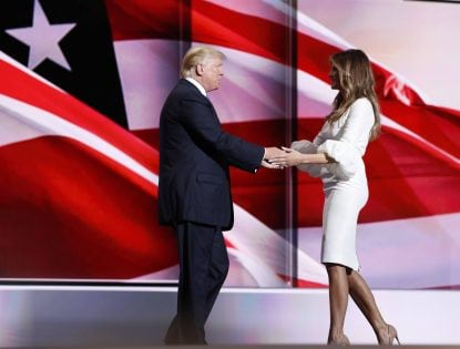 Melania Trump greets her husband Republican U.S. presidential candidate Donald Trump onstage at the Republican National Convention in Cleveland, Ohio, U.S. July 18, 2016. REUTERS/Mark Kauzlarich