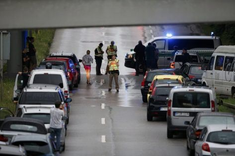 Police halt traffic on a road near to the scene of a shooting rampage at the Olympia shopping mall in Munich, Germany July 22, 2016. REUTERS/Michael Dalder