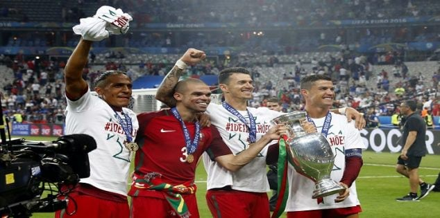 Football Soccer - Portugal v France - EURO 2016 - Final - Stade de France, Saint-Denis near Paris, France - 10/7/16 (L-R) Portugal's Bruno Alves, Pepe, Jose Fonte and Cristiano Ronaldo celebrate with the trophy after winning Euro 2016 REUTERS/Michael Dalder Livepic