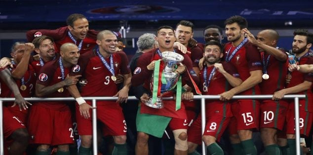 Football Soccer - Portugal v France - EURO 2016 - Final - Stade de France, Saint-Denis near Paris, France - 10/7/16 Portugal's Cristiano Ronaldo celebrates with team mates and the trophy after winning Euro 2016 REUTERS/Carl Recine Livepic