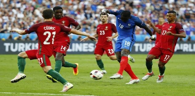 Football Soccer - Portugal v France - EURO 2016 - Final - Stade de France, Saint-Denis near Paris, France - 10/7/16 France's Moussa Sissoko in action with Portugal's Cedric REUTERS/Kai Pfaffenbach Livepic