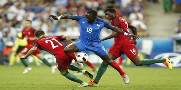 Football Soccer - Portugal v France - EURO 2016 - Final - Stade de France, Saint-Denis near Paris, France - 10/7/16 France's Moussa Sissoko in action with Portugal's Cedric and William Carvalho REUTERS/John Sibley Livepic