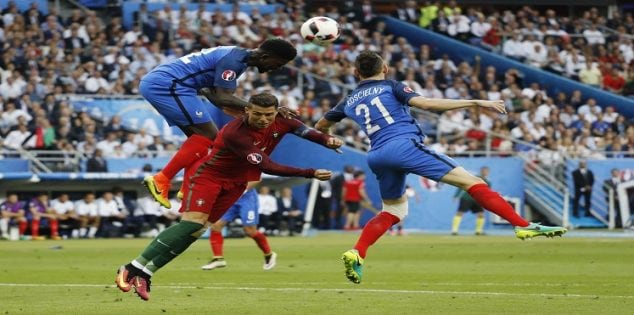 Football Soccer - Portugal v France - EURO 2016 - Final - Stade de France, Saint-Denis near Paris, France - 10/7/16 France's Samuel Umtiti and Laurent Koscielny in action with Portugal's Cristiano Ronaldo REUTERS/Darren Staples Livepic