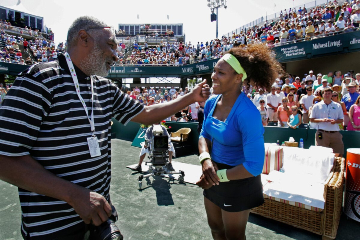 Richard Williams, father, congratulates Serena Williams of the United States after defeating Lucie Safarova of the Czech Republic during the finals of the Family Circle Cup Tennis Championship in Charleston, South Carolina, April 8, 2012. REUTERS/Mary Ann Chastain (UNITED STATES - Tags: SPORT TENNIS) - RTR30I8I