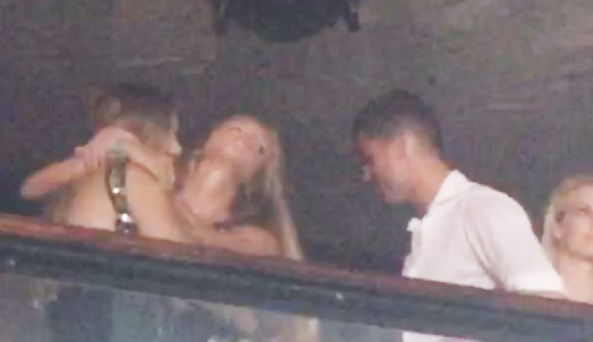 Cristiano Ronaldo pictured kissing a mystery blond in a club in Ibiza.