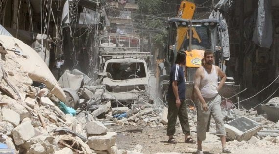 Residents inspect a damaged site after an airstrike on Aleppo's rebel held Al-Mashad neighbourhood, Syria July 26, 2016. REUTERS/Abdalrhman Ismail