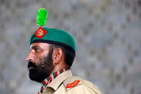 An army soldier stands during a flag hosting ceremony to celebrate the country's 70th Independence Day at the mausoleum of Muhammad Ali Jinnah in Karachi