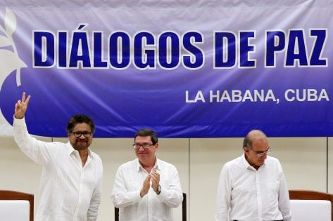 Colombia's FARC lead negotiator Ivan Marquez, Cuba's Foreign Minister Bruno Rodriguez and Colombia's lead government negotiator Humberto de la Calle, react after the signing a final peace deal in Havana, Cuba