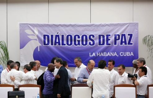 People talk after the ceremony of signing a final peace deal between the FARC and the Colombian government in Havana, Cuba