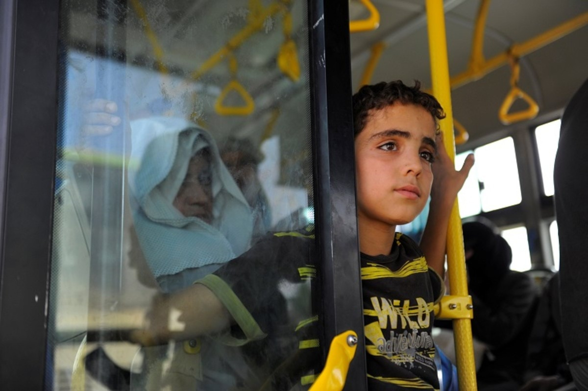 Civilians ride a bus to be evacuated from the besieged Damascus suburb of Daraya, after an agreement reached on Thursday between rebels and Syria's army, Syria, August 26, 2016. REUTERS/Omar Sanadiki