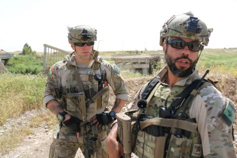 Canadian special operations forces soldiers have been working in northern Iraq advising and assisting local peshmerga soldiers in their battle against Daesh. Here, a corporal, left, and a sergeant, right, both special forces operators, are seen on a security detail in an area west of Erbil, just a short distance from the front line. Picture taken Apr. 28, 2016. Uploaded external by: Campion-Smith, Bruce