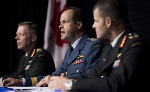 General Tom Lawson, Chief of the Defence Staff, centre, takes a question during a technical briefing on Operation IMPACT, Canada's support to the mission against the Islamic State of Iraq and the Levant (ISIL) as Lieutenant-General Jonathan Vance, Commander Canadian Joint Operations Command, left, and Brigadier-General Michael Rouleau, Commander Canadian Special Operations Forces Command, look on in Ottawa on Friday, Oct. 17, 2014. THE CANADIAN PRESS/Justin Tang