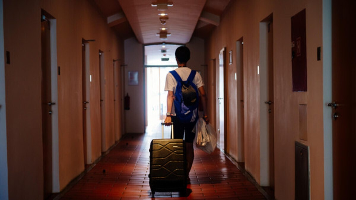 (FILES) This file photo taken on July 29, 2016 shows a tourist walking through a hallway on the way to a room in the hostel Celica in Ljubljana. Fancy spending the night in a former military prison that is now a youth hostel with an artistic twist? In Slovenia you can, and with a clear conscience about your ecological footprint. The technicolour building in Ljubljana was originally a jail built by the occupying Austro-Hungarian army in 1882 and remained in use until Yugoslavia fell apart in the early 1990s. / AFP PHOTO / Jure MAKOVEC / TO GO WITH AFP STORY BY Bojan KAVCIC