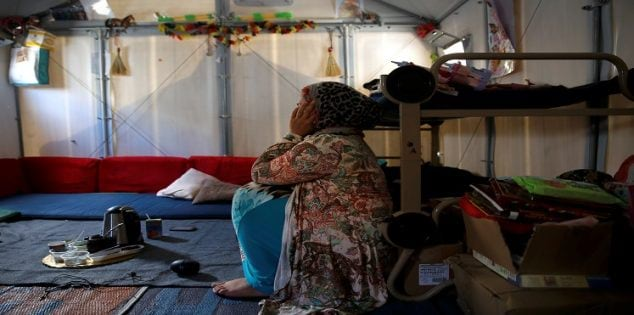 Syrian refugee Walaa, 26, sits inside her family's tent at the Souda municipality-run camp on the island of Chios, Greece, September 7, 2016. Picture taken September 7, 2016. To match EUROPE-MIGRANTS/CHIOS REUTERS/Alkis Konstantinidis