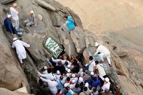 Muslim pilgrims visit the Hera cave, where Muslims believe Prophet Mohammad received the first words of the Koran through Gabriel, at the top of Mount Al-Noor, ahead of the annual haj pilgrimage in the holy city of Mecca, Saudi Arabia September 7, 2016. REUTERS/Ahmed Jadallah TPX IMAGES OF THE DAY