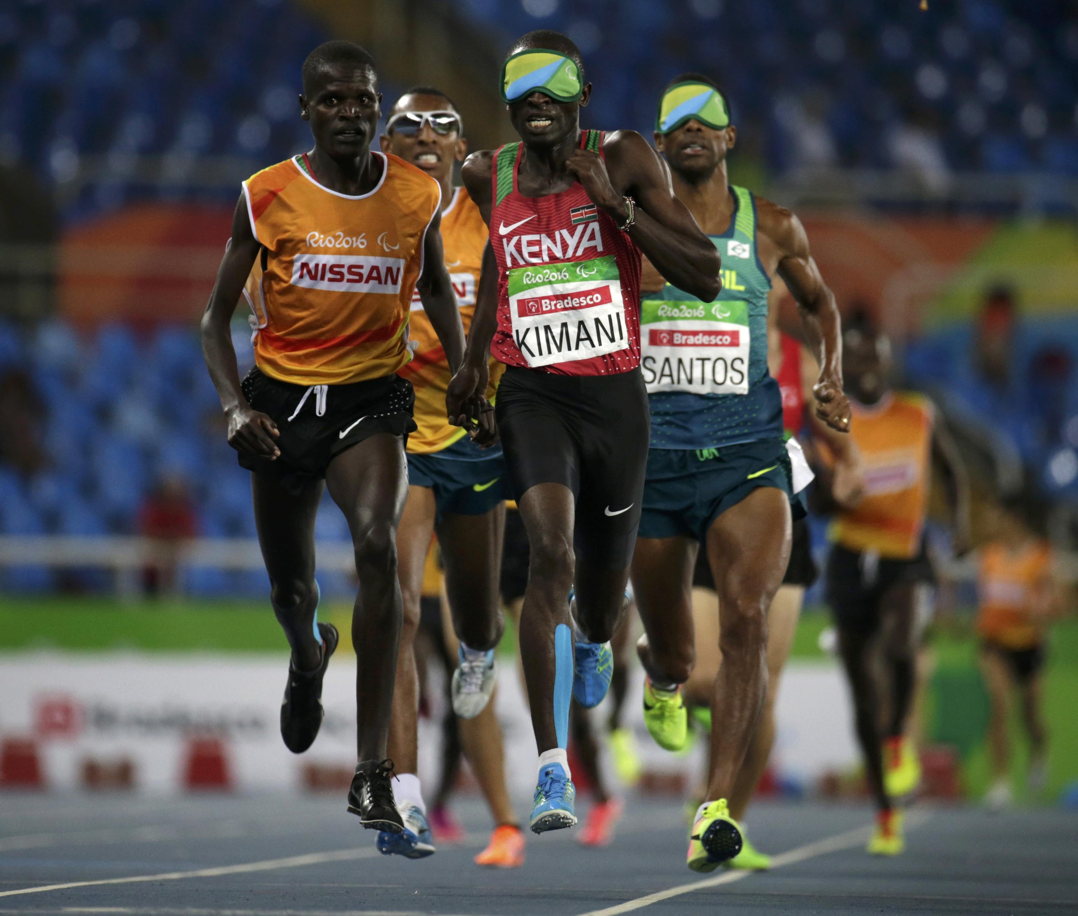 2016 Rio Paralympics - Athletics - Men's 1500m - T11 Final - Olympic Stadium - Rio de Janeiro, Brazil - 13/09/2016. Samwel Mushai Kimani of Kenya leads the pack with his guide James Boit while on his way to winning the gold medal in the event. REUTERS/Ricardo Moraes FOR EDITORIAL USE ONLY. NOT FOR SALE FOR MARKETING OR ADVERTISING CAMPAIGNS.