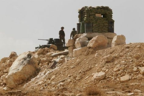 Lebanese soldiers stand at an army post in the hills above the Lebanese town of Arsal, near the border with Syria, Lebanon September 21, 2016. Picture taken September 21, 2016. REUTERS/Mohamed Azakir