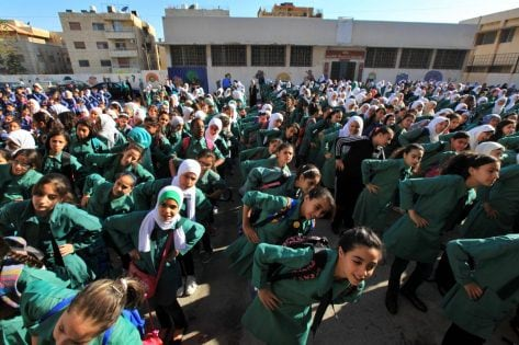 (150901) -- AMMAN, Sep. 1, 2015 -- Jordanian schoolgirls do morning exercises on the first day of school, in Amman, Jordan, on Sept. 1, 2015. Around 1.9 million students started attending classes at 6,924 public, private, military and UNRWA schools on Tuesday.Mohammad Abu Ghosh) JORDAN-AMMAN-SCHOOL chengchunxiang PUBLICATIONxNOTxINxCHN 150901 Amman Sep 1 2015 Jordanian school girls Do Morning exercises ON The First Day of School in Amman Jordan ON Sept 1 2015 Around 1 9 Million Students started attending Classes AT 6 924 Public Private Military and UNRWA Schools ON Tuesday Mohammad Abu Ghosh Jordan Amman School chengchunxiang PUBLICATIONxNOTxINxCHN