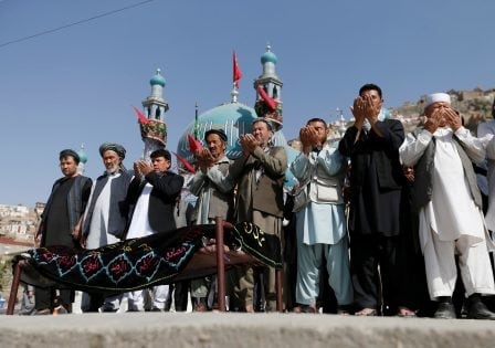 Afghan Shi'ite Muslims perform prayers at the funeral for one of the victims of Tuesday's attack at the Sakhi Shrine in Kabul, Afghanistan