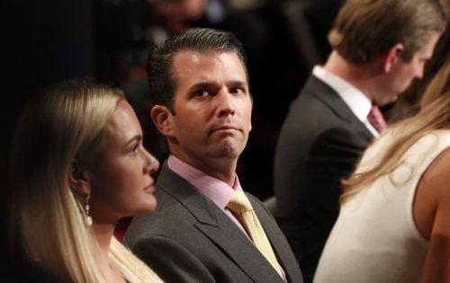 Donald Trump Jr. sits between his wife Vanessa (L) and his brother Eric Trump (R) during the third and final debate between Republican U.S. presidential nominee Donald Trump and Democratic nominee Hillary Clinton at UNLV in Las Vegas, Nevada, U.S., October 19, 2016. REUTERS/Rick Wilking