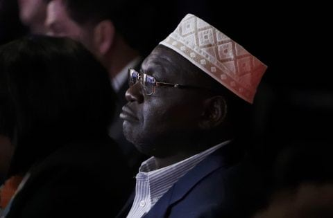 President Barack Obama's half brother Malik, a guest of Republican U.S. presidential candidate Donald Trump, sits in the crowd watching the third and final 2016 presidential campaign debate at UNLV in Las Vegas, Nevada, U.S., October 19, 2016. REUTERS/Carlos Barria