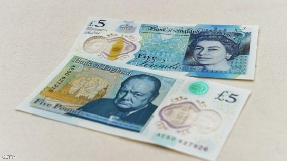 The new £5 (6.5 euros, $7.2) banknote bearing the image of wartime leader Winston Churchill is on show at its unveiling by the Bank of England at Blenheim Palace in Woodstock on June 2, 2016. The note, to be rolled out from September, is the first to be printed on polymer -- a thin, flexible plastic film that is seen as more durable and secure and is already used in Australia and Canada. / AFP / POOL / Joe Giddens (Photo credit should read JOE GIDDENS/AFP/Getty Images)