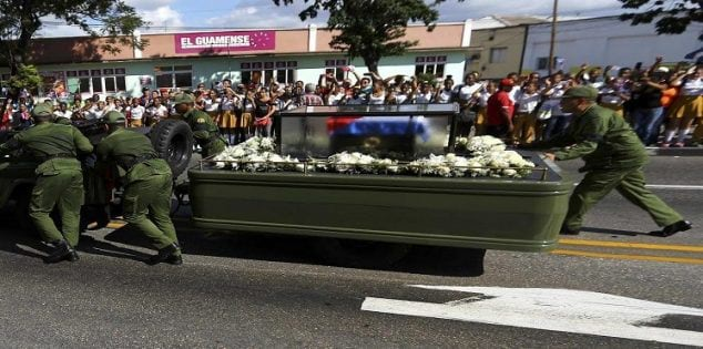 Soldiers push the vehicle and trailer carrying the ashes of Cuba's late President Fidel Castro after suffering a mechanical issue in Santiago de Cuba, Cuba, December 3, 2016. REUTERS/Ivan Alvarado