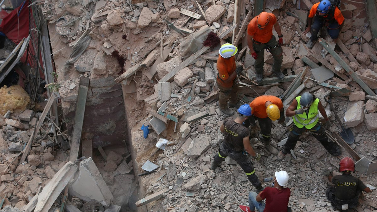 rescue-team-search-through-rubble-of-buildings-damaged-due-to-the-massive-explosion-at-beiruts-port-area